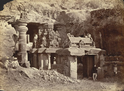 [General view from the left of the façade of the Indra Sabha Jain Cave Temple (Cave XXXII), Ellora, before the pillar fell.]